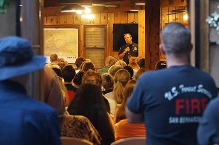 firefighter leading a community meeting