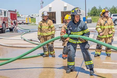 female firefighters on hoseline during a training drill